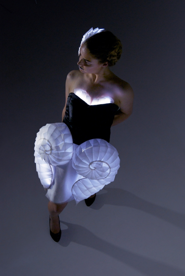 """""""Cane and paper sculpting by Flavia Rose, electronics by Ash King, sewing and design by Bianca Taylor"""""""